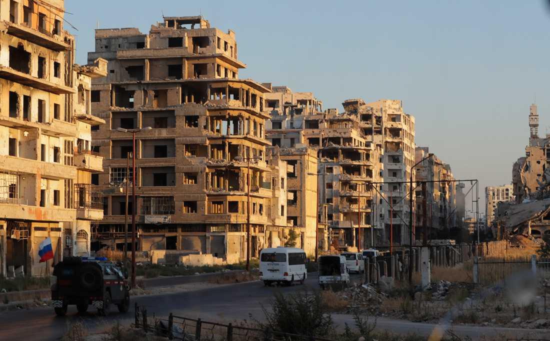 Den gripne läkaren anklagas för tortyr i ett fängelse i Homs (staden på bilden) i Syrien. Arkivbild.