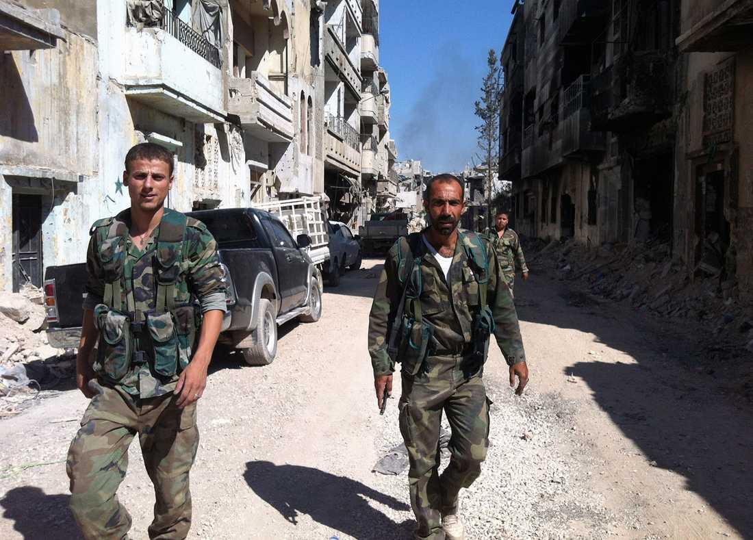 Regimtrogna trupper i Homs, Syriens tredje största stad.