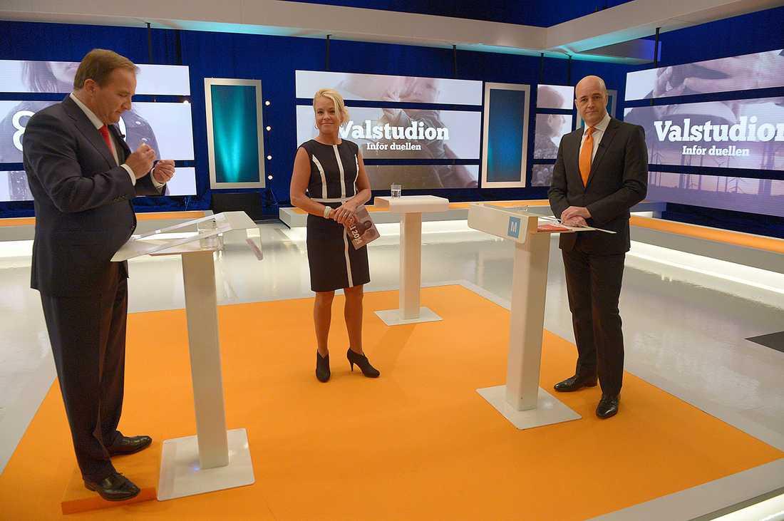 Stefan Löfven och Fredrik Reinfeldt med Karin Hübinette under debatten.