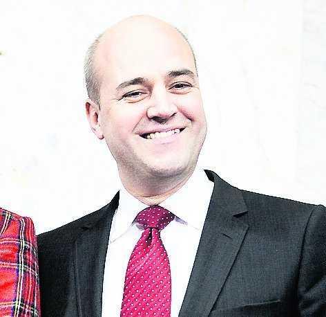 Upp Fredrik Reinfeldt.