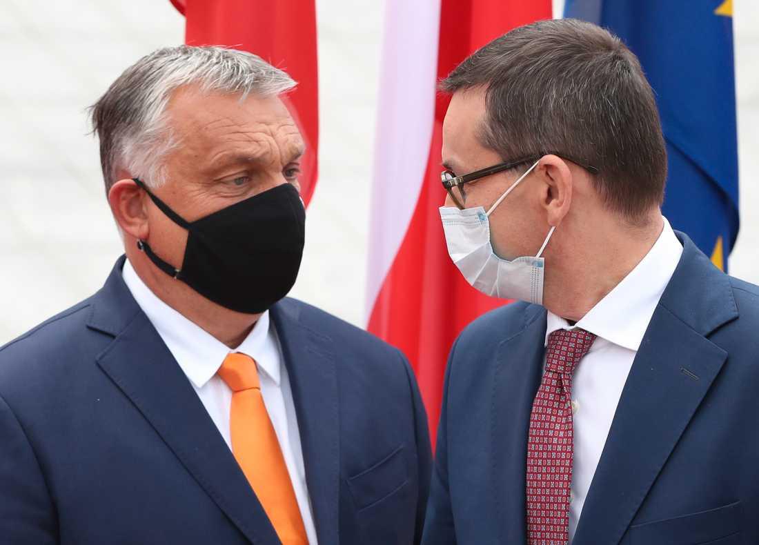 Ungern och Polen – här i form av premiärministrarna Viktor Orbán och Mateusz Morawiecki – säger fortsatt nej till EU:s nästa långtidsbudget. Arkivfoto.