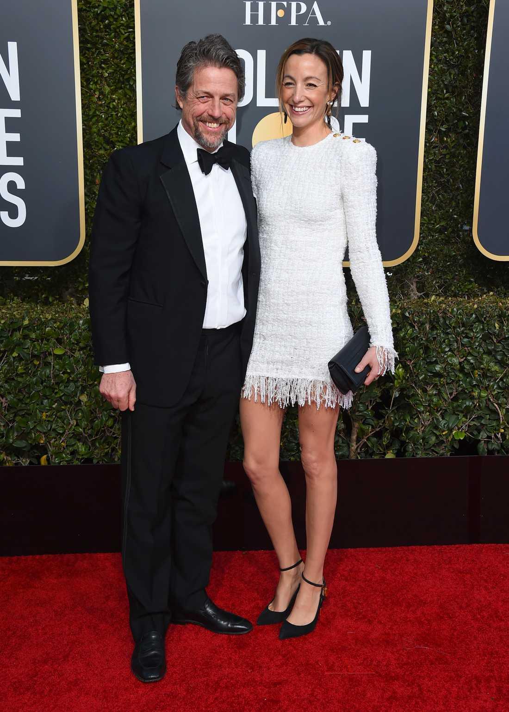Hugh Grant och Anna Eberstein vid Golden Globe Awards i januari 2019.