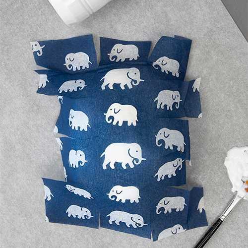TIPS! Försök få vecken mellan motiven, i det här fallet elefanterna.
