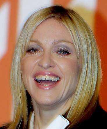 Madonna tydcker inte att hon har nog med hus.