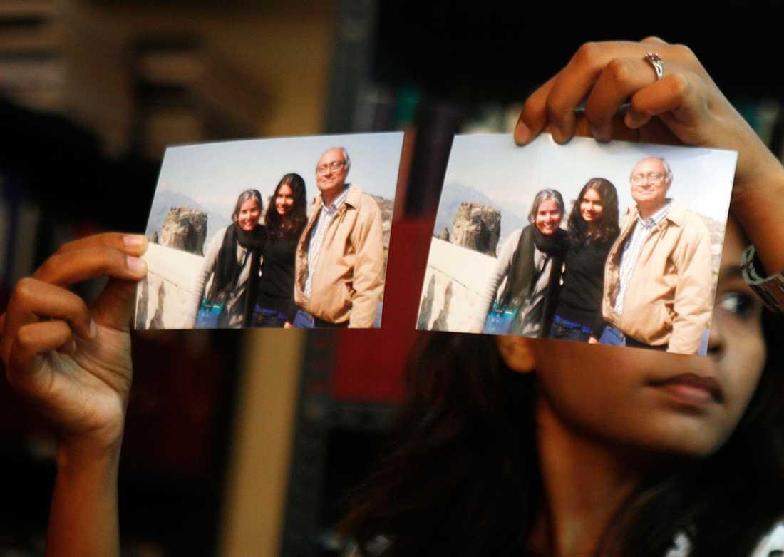 Narandran Sharma saknas i flygkatastrofen. Hon är till vänster på fotot, med sin man och dotter.