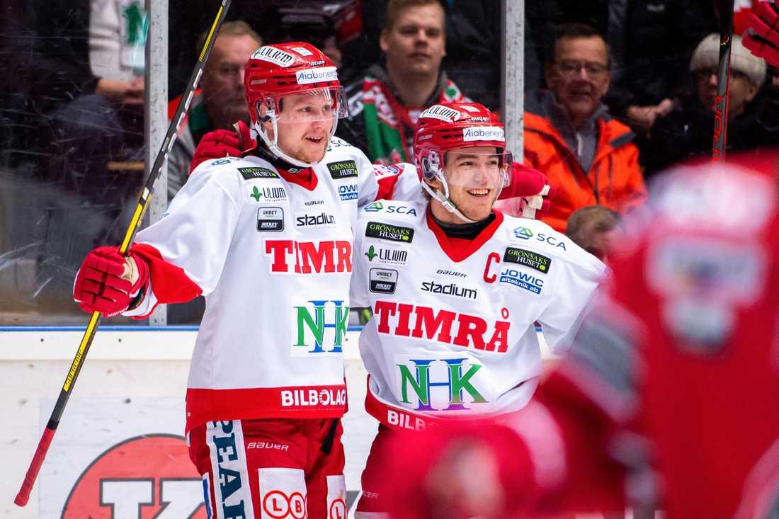 Berglund till höger.