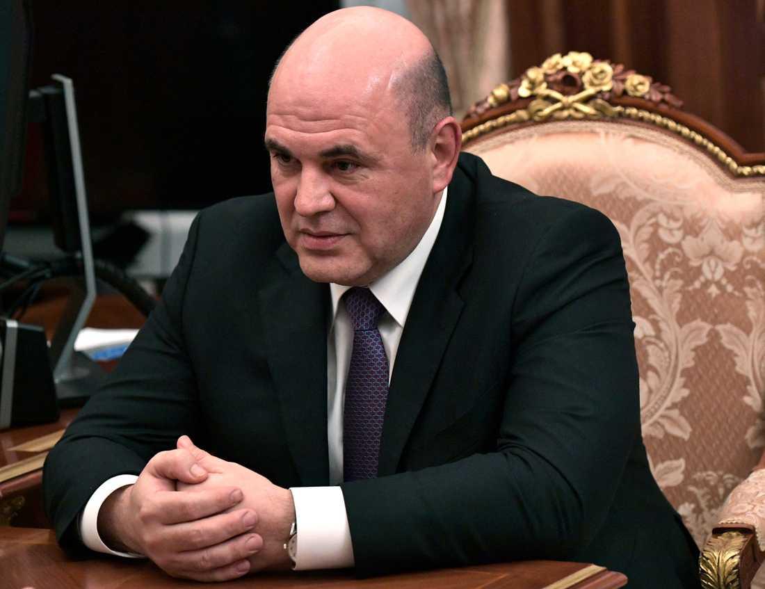 Michail Misjustin har godkänts som Rysslands nya premiärminister av statsduman. Bilden är tagen under ett möte med president Vladimir Putin på onsdagen.