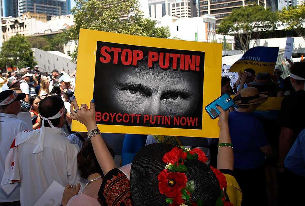 Protester mot Putin under G20-mötet.