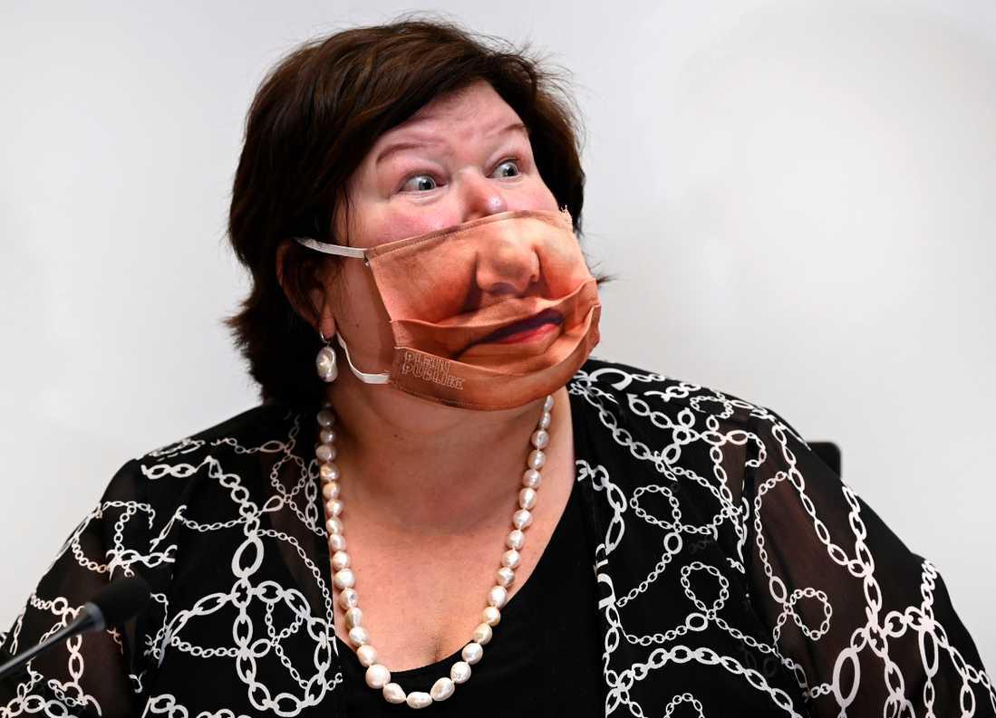 Hälsominister Maggie de Block med munskyddet.