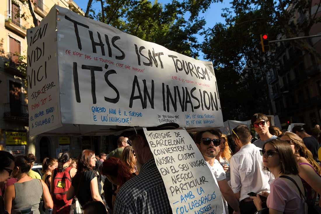 Protester mot turister i Barcelona tidigare i sommar.