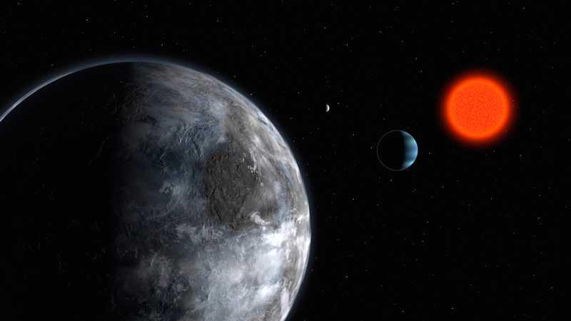 Illustrationen visar potentiellt beboeliga planeter kring röda stjärnan Gliese 581.
