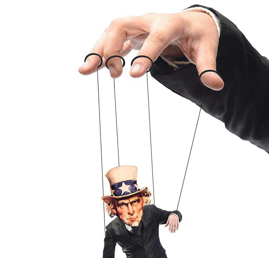 """Handen som styr USA –elitgruppen som Thomas Frank Kallar """"De professionella"""" består bland annat av toppar inom finans, politik, pr och media."""
