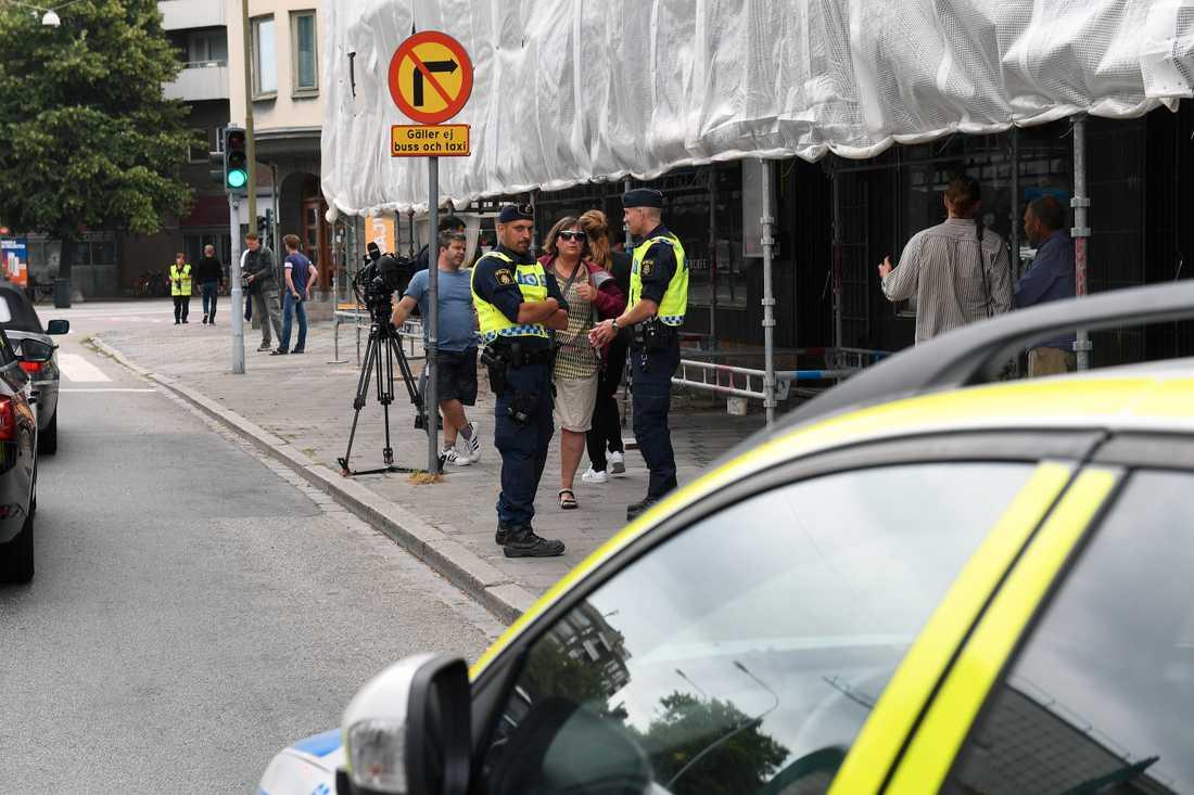 Malmö dagen efter att tre människor skjutits till döds på öppen gata.