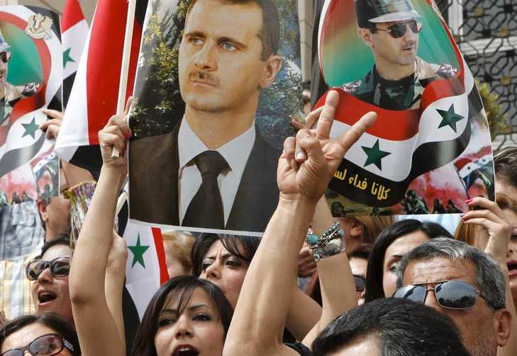 Presidentens anhängare demonstrerar i Damaskus den 30 april.