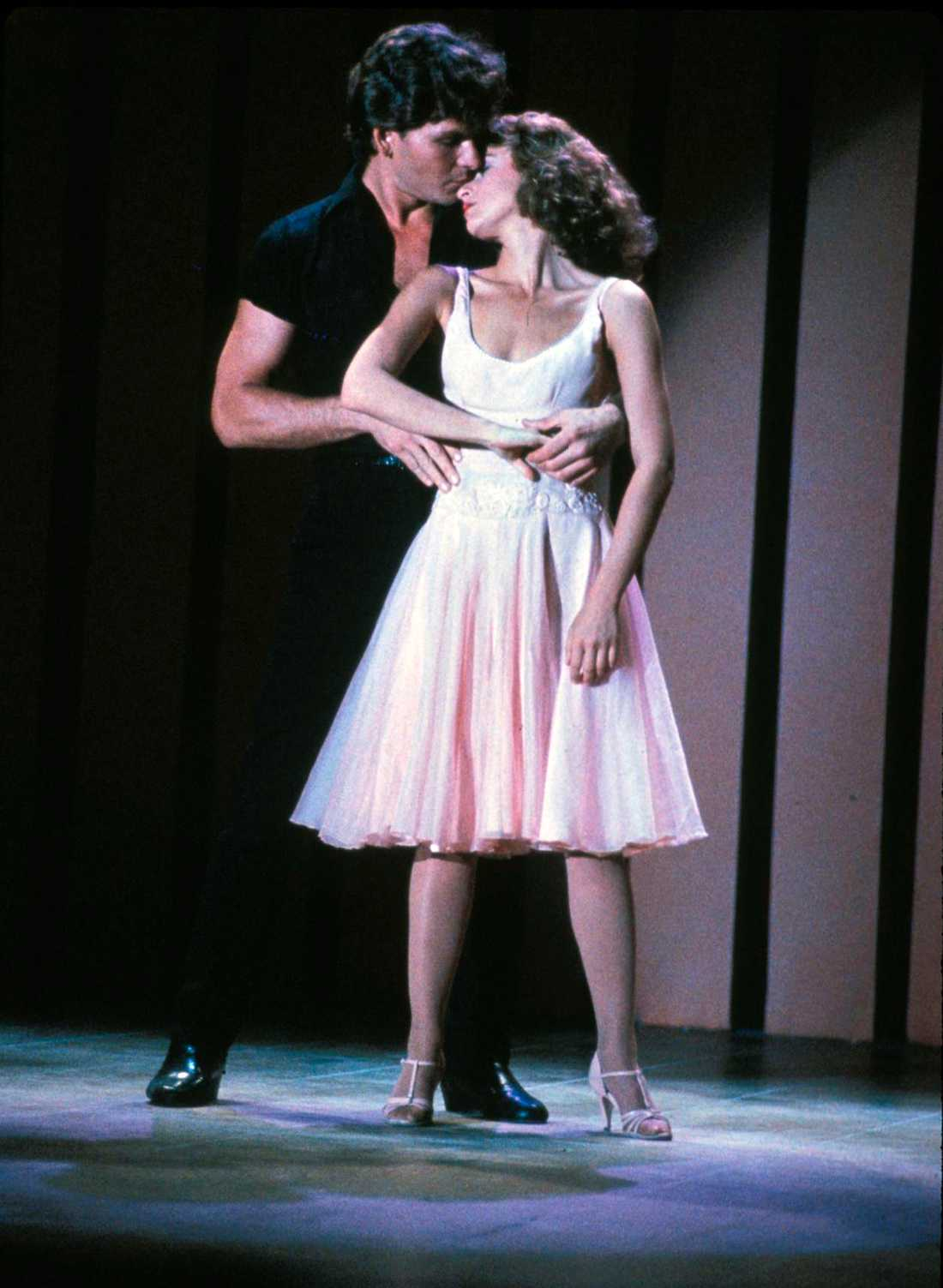 "Patrick Swayze som Johnny Castle och Jennifer Grey som Baby Houseman i filmen ""Dirty Dancing"" från 1987."