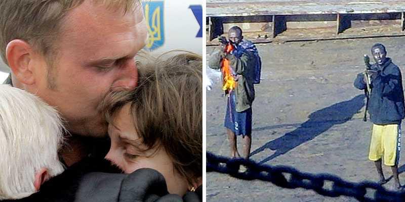 En av de hemkomna besättningsmännen kramar sina anhöriga under det gripande återseendet på flygplatsen, efter månaderna hos piraterna på Faina.