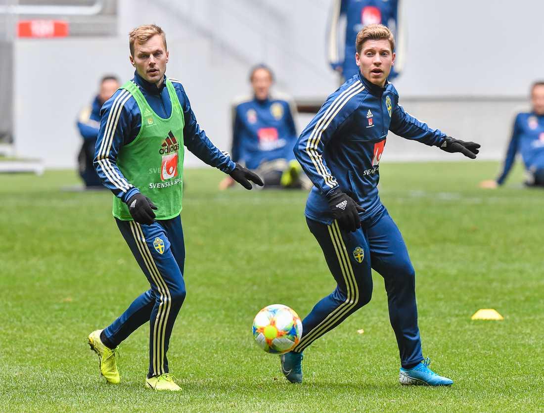 Alexander Fransson (höger) lär få slåss med bland annat Sebastian Larsson (vänster) om en plats i den svenska EM-truppen. Arkivbild.