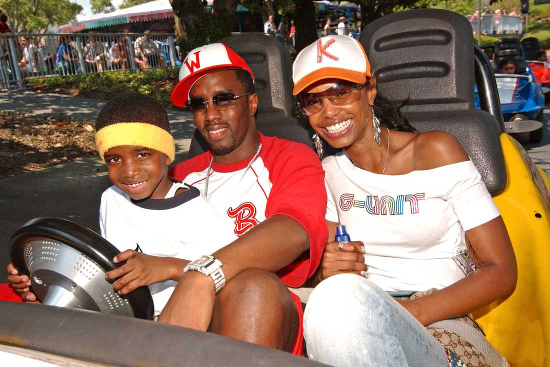 Diddy och Kim Porter på Disneyland med sonen Christian 2005.