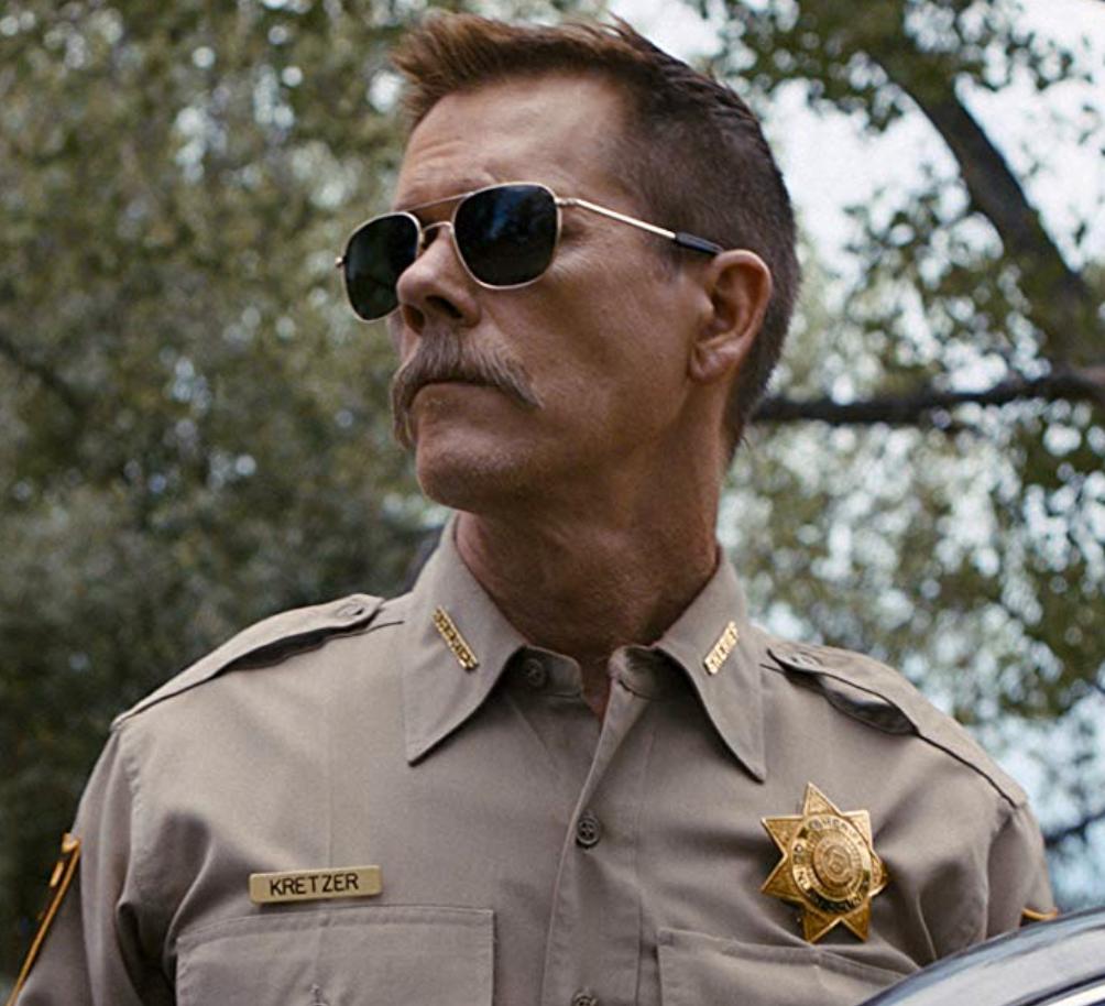 "Kevin Bacon i ""Cop car""."