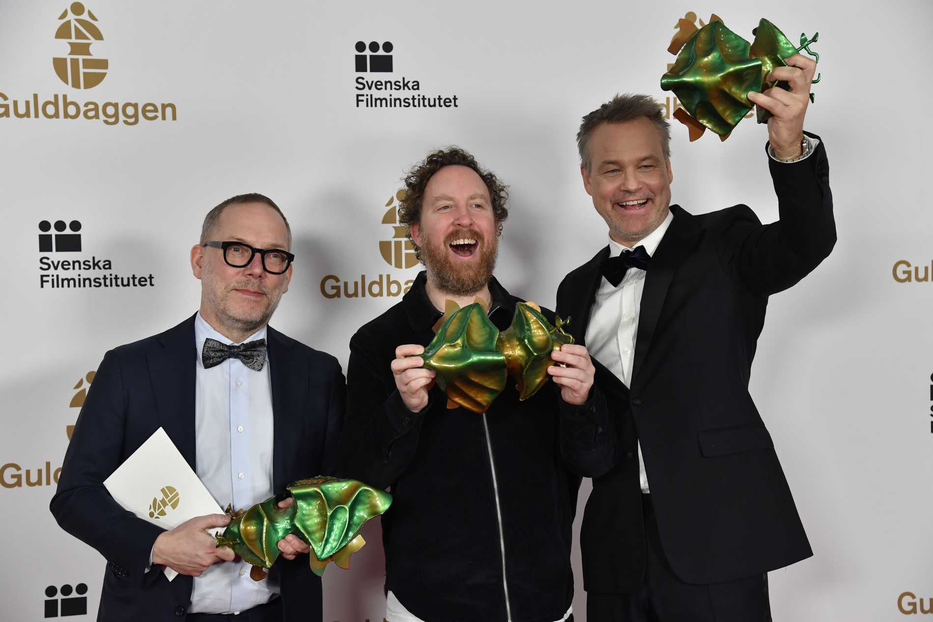Producenten Tomas Michaelsson, Uje Brandelius och Henrik Schyffert vann bästa film för Spring Uje spring.