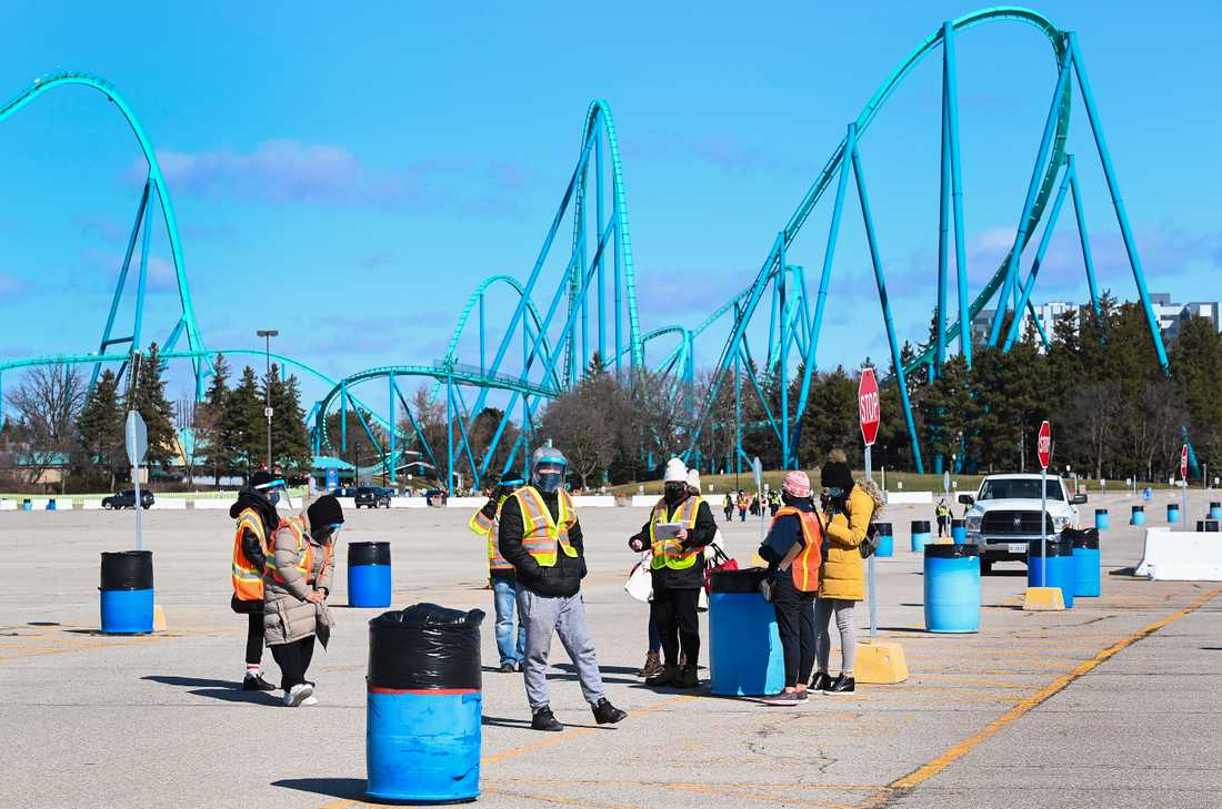 Wonderland theme park in Vaughan, Ontario, has been transformed into a comprehensive vaccination site where healthcare professionals receive patients outdoors.