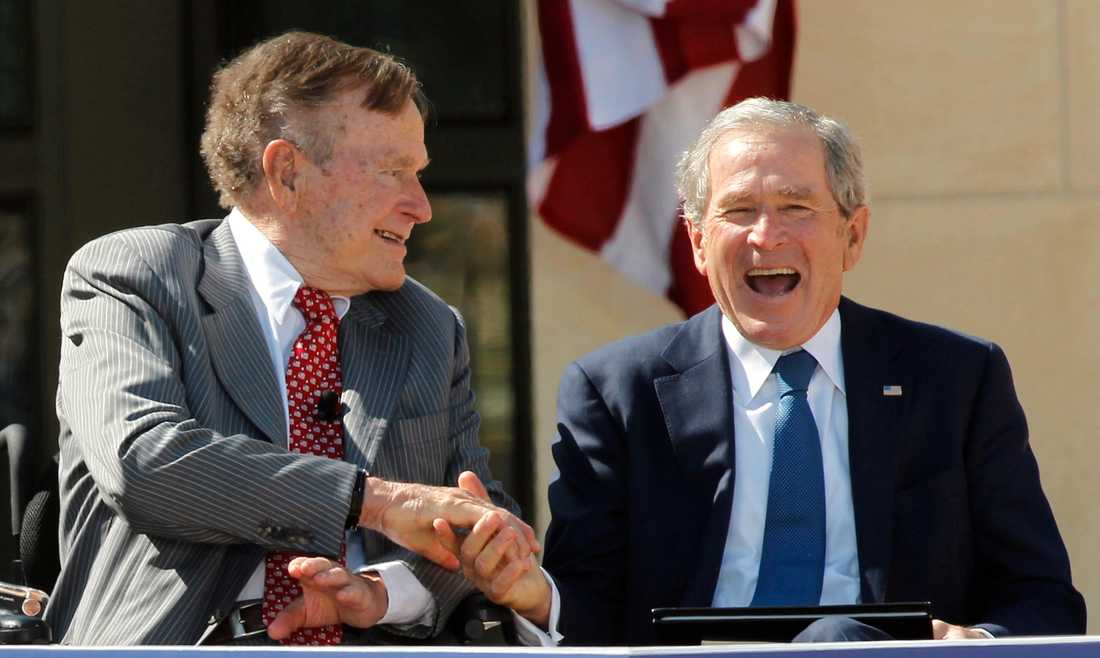 Father and son, both former U.S. Presidents, George H.W. Bush (L) and George W. Bush, shake hands at the dedication for the George W. Bush Presidential Center on the campus of Southern Methodist University in Dallas, Texas April 25, 2013.