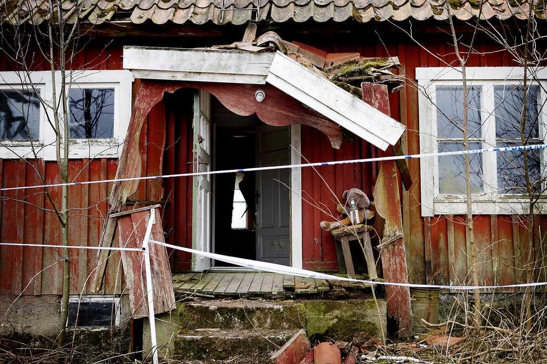 Huset …där kvinnan misstänks ha hållits mot sin vilja.