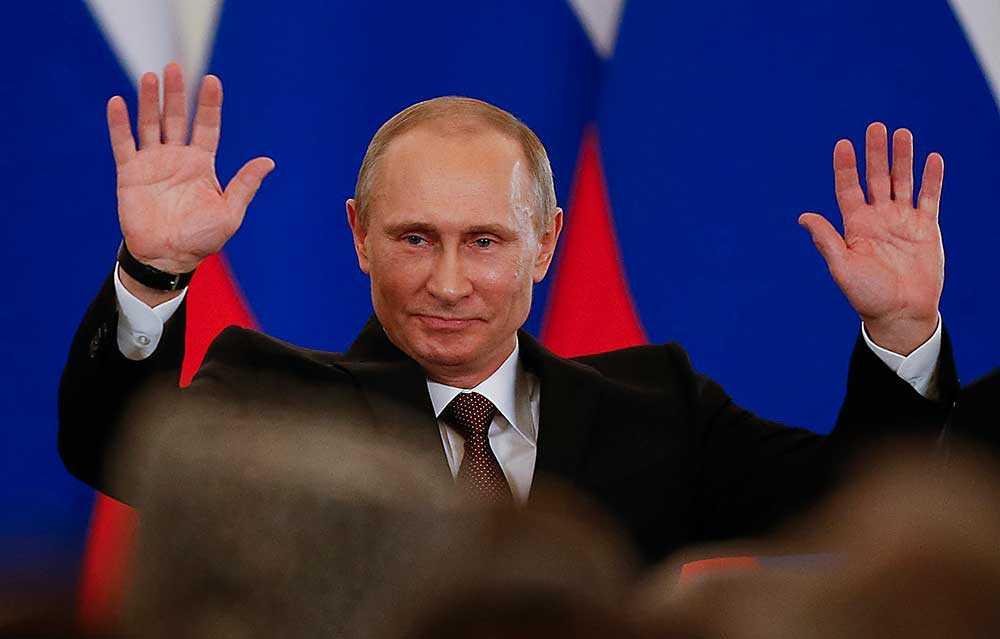 Putin efter att officiellt ha annekterat Krim
