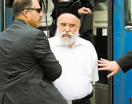 Levy Izhak Rosenbaum being led away by FBI agents. Rosenbaum is alleged to have functioned as a middleman in the illegal organ trafficking scheme.