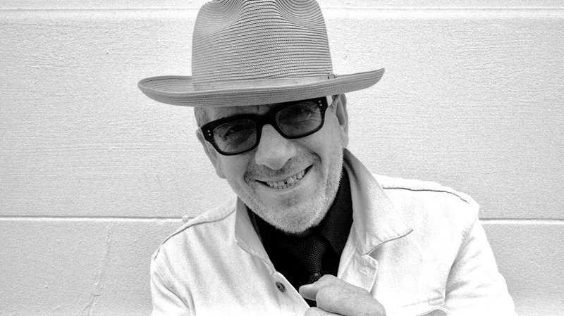 Elvis Costello har åkt världen runt för att spela in sitt nya album.