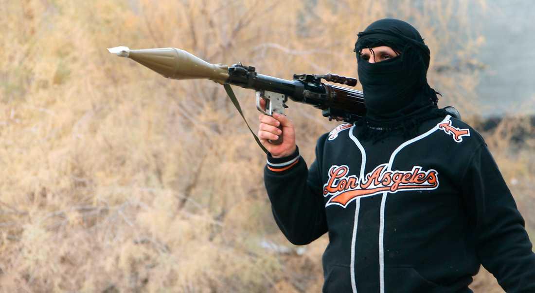 NY VÅG AV MASSMÖRDARE En jihadistkrigare med raketgevär i Irak, 2014. Sedan IS övertog ledarrollen för den internationella terrorn har en helt ny våg av suicidala unga män lockats till terrorismen.