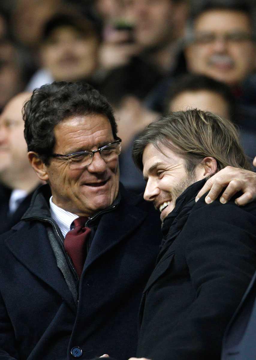 Fabio Capello och Beckham på Old Trafford i januari 2011.