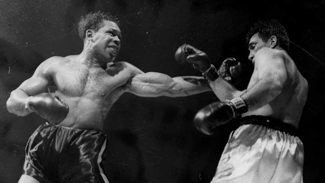 Archie Moore (1913-1998) (t.v.) var mest framgångsrik i klassen lätt tungvikt men boxades även som renodlad tungviktare och är den ende som mött både Rocky Marciano och Muhammad Ali. På bilden besegrar han Joey Maxim efter en legendarisk match som gick över 15 ronder.
