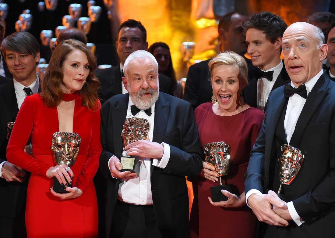 Julianne Moore, winner of the Leading Actress award, Mike Leigh winner of the special award for Outstanding British Contribution to Cinema, Patricia Arquette, winner of Best Supporting Actress and J.K. Simmons winner of the Best Supporting actor pose on the stage, during the British Academy  Film and Television Awards 2015, at the Royal Opera House, in London.