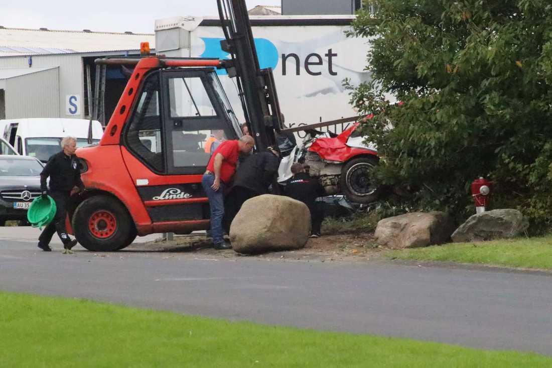 Två personer har dött efter att ha blivit påkörda av en rallybil under en tävling i Randers, Danmark.