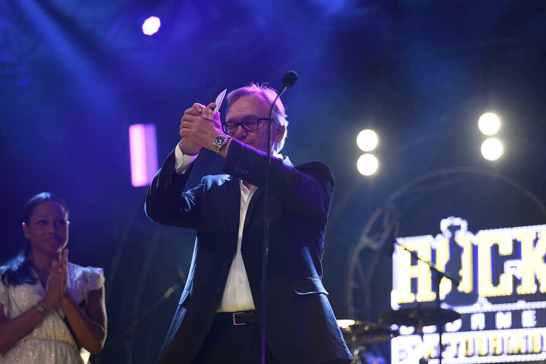 Avicii's father Klas Bergling on stage accepting a Rockbjörnen award on behalf of his son
