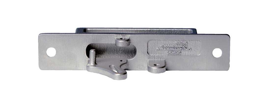 Del av dörrlås, 3D-printad i rostfritt stål åt SJ. Originalet tillverkades på 1940-talet i aluminium med en process som i dag skulle vara dyr att reproducera.