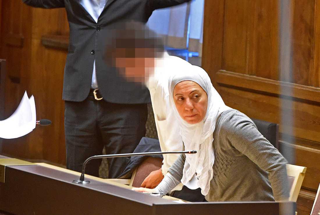 Den misstänkte 21-åringen tillsammans med en tolk i Stockholms tingsrätt.