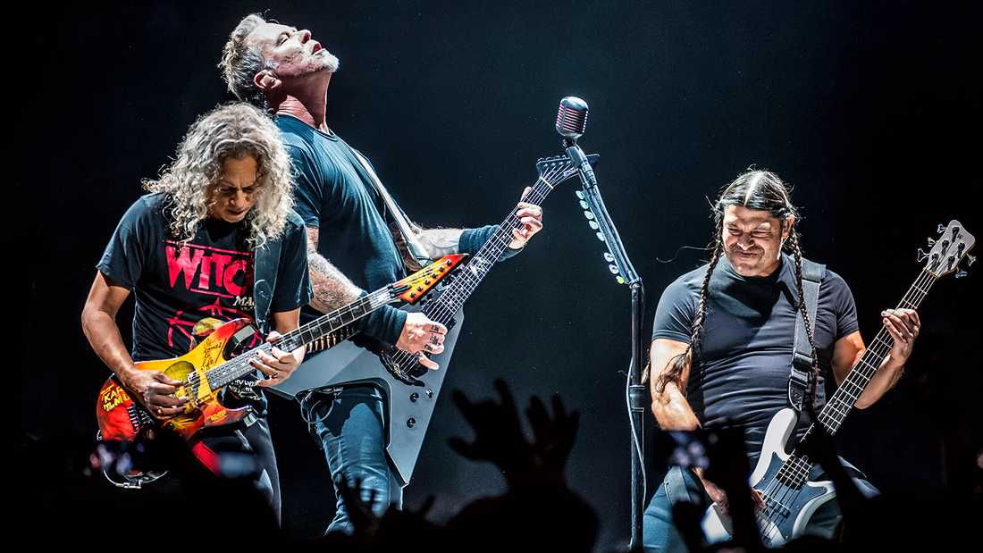 Kirk Hammett, James Hetfield och Robert Trujillo i Metallica.
