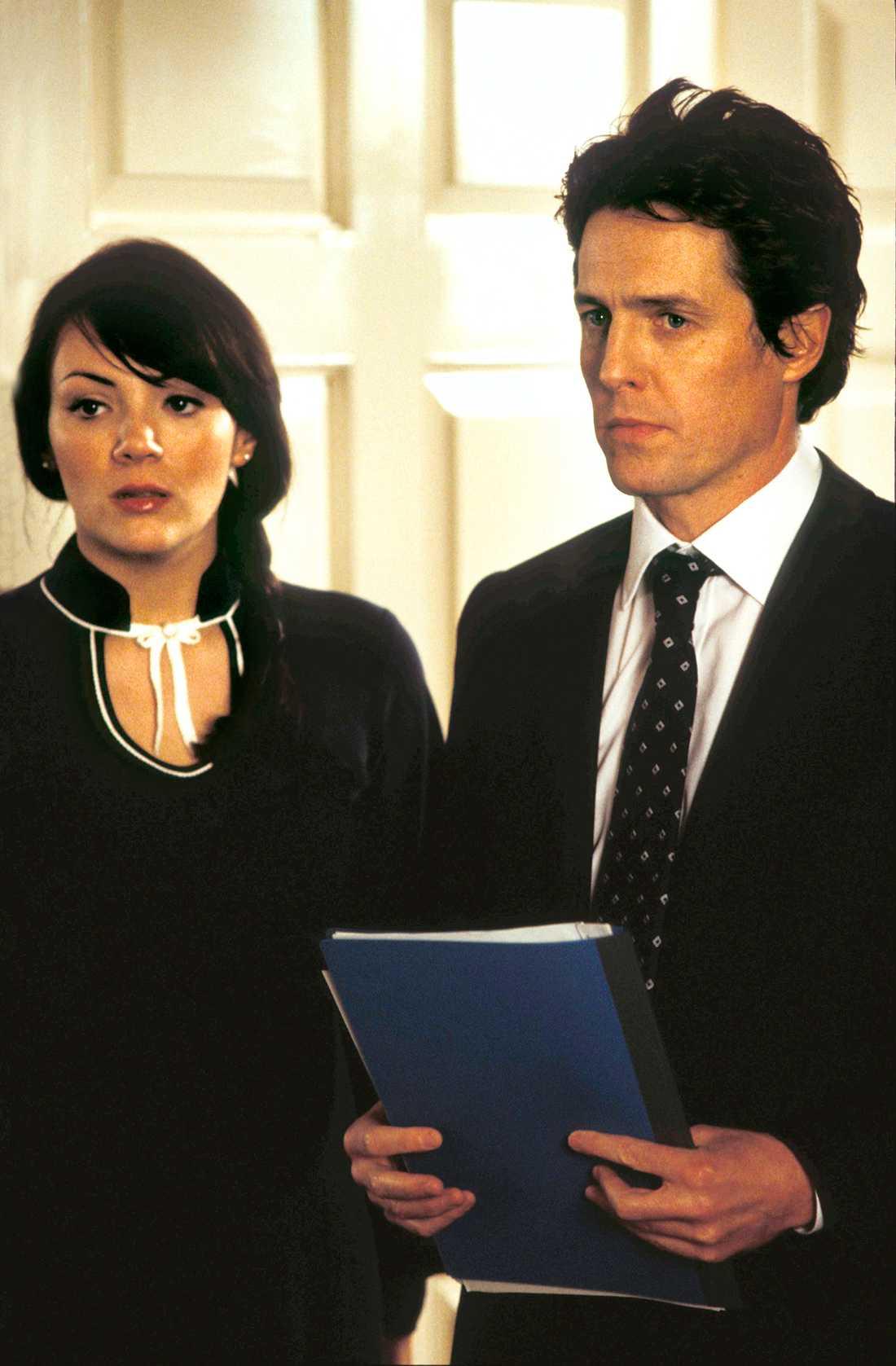 Martine Mccutcheon och Hugh Grant.