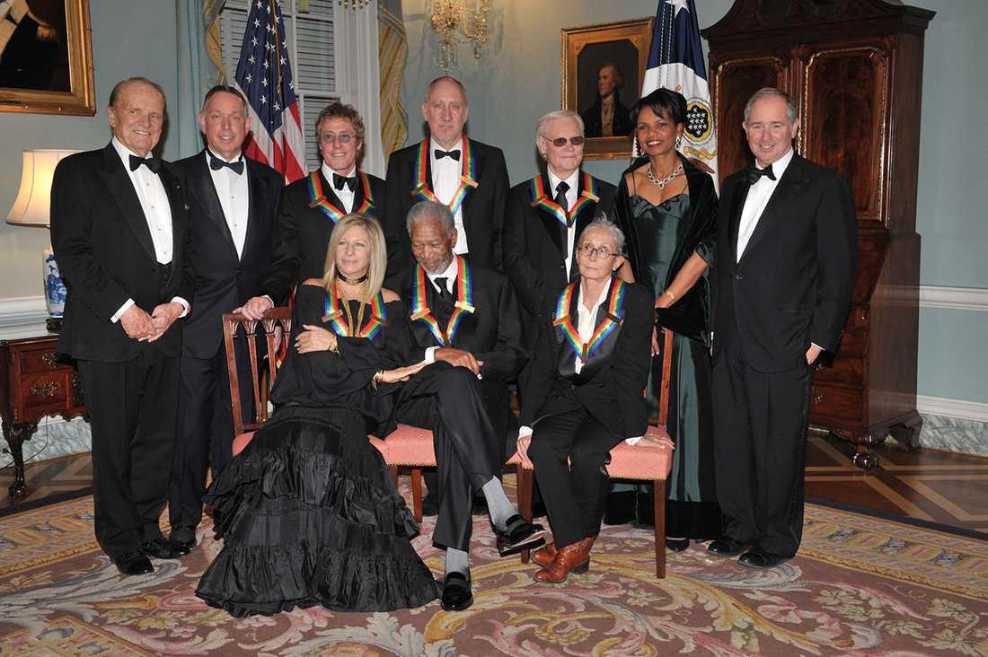 Countrystjärnan med bland annat tidigare utrikesministern Condoleezza Rice och skådespelaren Morgan Freeman under en prisceremoni 2008.