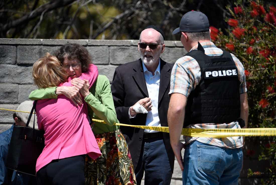 En person har dött och flera skadats i det som tycks vara ett hatbrott.