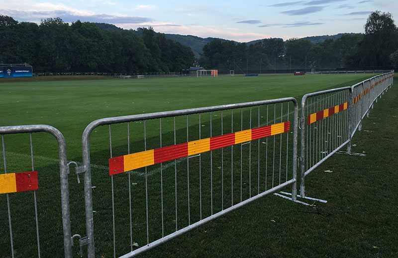 Tre meter gräs har lagts runt fotbollsplanen efter önskemål från förbundet.