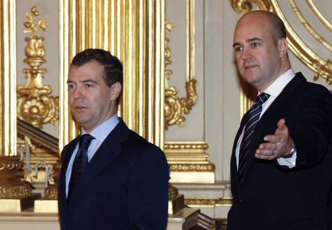 Rysslands president och Sveriges dåvarande statsminister Fredrik Reinfeldt före EU-toppmötet 2009.