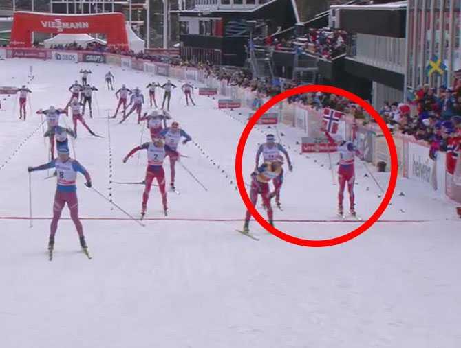 Krogh vänder sig om innan mållinjen, anser sig ha blivit felaktigt behandlad av ryssen.