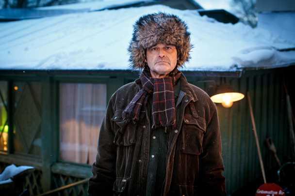 Johan Rheborg som Eskil Ek.