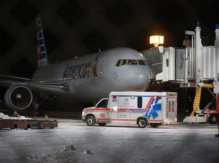 Flera fick föras till sjukhus när American Airlines-plan tvingades gå ned för landning på St Johns flygplats när besättning och passagerare blev sjuka.