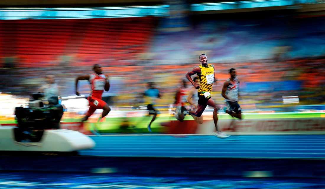 Under semifinalen på 200 meter i VM 2013 i Moskva kostade en överlägsen Bolt på sig att le in i kameran.