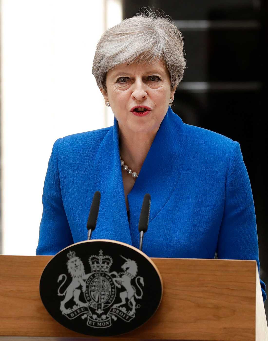 Theresa May efter att ha träffat drottningen.