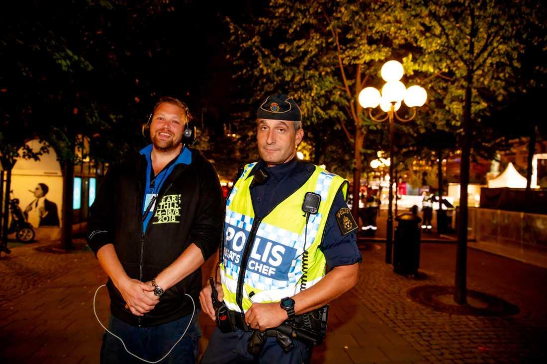 Polisen Krister Olofsson och säkerhetschefen för festivalen We are Sthlm Martin Berg.